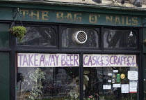 06-01-2021 - Pub closed, Covid 19 lockdown but allowed to sell take out beer, Bristol. Take away beer sign at The Bag of Nails © Paul Box
