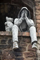 11-01-2021 - World Suicide Prevention Day, sculpture of a youth in a hoodie holding his head in his hands in dispair with a teddy bear comforting him, Bristol © Paul Box