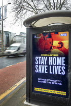 12-01-2021 - Stay home, Save lives bus stop lockdown NHS advertisement, Broadmead, Bristol. Reduce Contact To Reduce The Spread, public health message © Paul Box