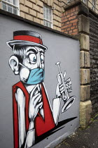 12-01-2021 - Covid-19 out of work musician mural, Bristol. Freelance trumpet player unable to blow due to face mask. Musicians without work due to pandemic © Paul Box