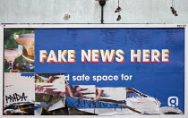 20-01-2021 - Defaced No Fake News Here billboard, Bristol. Global Media & Entertainment radio news services billboard advertisement reading Fake News Here © Paul Box