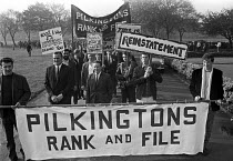 12-10-1970 - Pilkington Glass, St Helens, 1970 sacked trade union members rank and file after their bitter 6 week strike, prepare to march through the town demanding reinstatement. The company was famous for its p... © NLA