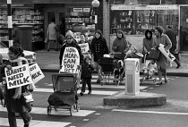 23-12-1970 - Mothers protest at the ban on free school milk, 1970, Brixton, London. Margaret Thatcher gained the reputation of Milk Snatcher © Peter Arkell