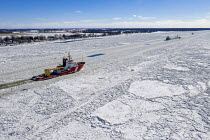 07-02-2021 - Roberts Landing, Michigan: USA. Canadian Coast Guard icebreaker Samuel Risley breaking up ice on the St. Clair River. The St. Clair River is the border between the USA and Canada © Jim West