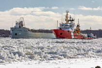 07-02-2021 - Roberts Landing, Michigan, USA: The St Marys Challenger navigating ice on the St. Clair River aided by Canadian Coast Guard icebreaker Samuel Risley. Built in 1906 as a self-propelled ore carrier, the... © Jim West