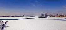 19-02-2021 - Detroit, USA: The partially frozen Detroit River. Downtown Detroit (R) and Windsor, Ontario, Canada © Jim West