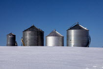 20-02-2021 - Sanilac Township, Michigan, USA: Steel grain storage silos in winter snow © Jim West
