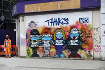03-03-2021 - Thanks NHS graffiti murial by artists Bowen and Blackmore, Covid pandemic lockdown, Oxford Street, London © Jess Hurd