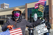06-03-2021 - Detroit, USA: Workers trying to unionise Amazon rally in front of a Whole Foods market store, a chain owned by Amazon. Workers are trying to organise a union at a warehouse in Bessemer, Alabama. It wo... © Jim West