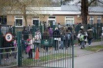 08-03-2021 - Pupils returning to Primary school after months of remote learning as COVID-19 lockdown restrictions. Children and parents at the school gates, Holy Trinity C of E Primary School, Stratford upon Avon,... © John Harris