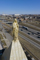 05-03-2021 - Detroit, USA: Statue of Mary on the steeple, The Our Lady of the Rosary Roman Catholic Church above Interstate 94. © Jim West