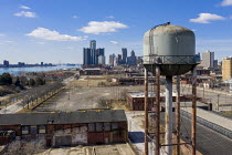 07-03-2021 - Detroit, USA: Water tower, disused warehouse and industrial area on the east riverfront. General Motors HQ building. © Jim West