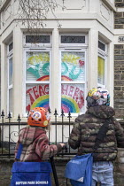 10-03-2021 - Thank You Teachers sign in the window of a home, Bristol. Pupils stop to look at a tribute to teachers during Coronavirus lockdown on their way to Primary School as school students return © Paul Box