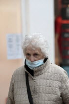05-03-2021 - Elderly woman shopping with a half on face mask, Stratford upon Avon, Warwickshire © John Harris