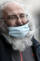 05-03-2021 - Elderly man shopping with a half on face mask, Stratford upon Avon, Warwickshire © John Harris