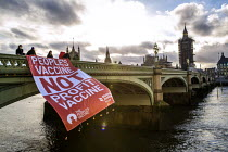11-03-2021 - People's Vaccine Not Profit Vaccine banner drop from Westminster Bridge, London. Global Justice Now and The People's Vaccine campaigning for global vaccine equality. Big Pharma should lift patents and... © Jess Hurd