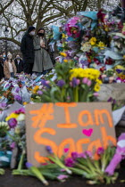 13-03-2021 - Floral tributes. Vigil for Sarah Everard, the Bandstand, Clapham Common, South London in memory of murdered Sarah Everard. Women gathered to pay tribute and to Reclaim the Night against male violence © Jess Hurd