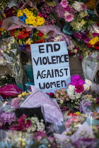 13-03-2021 - Floral tributes. Vigil for Sarah Everard, the Bandstand, Clapham Common, South London in memory of murdered Sarah Everard. Women gathered to pay tribute and to Reclaim the Night against male violence.... © Jess Hurd