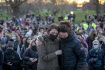 13-03-2021 - Two women comfort each other, Vigil for Sarah Everard, The Bandstand, Clapham Common, South London. Women gathered to pay tribute to the murdered woman and to Reclaim the Night against male violence.... © Jess Hurd