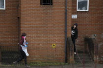 19-03-2021 - Youth greeting care worker, block of flats, Banbury © John Harris