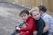 22-03-2021 - Travellers children riding a quad bike, Hovefields Drive. They are facing eviction as a court injunction banning all residential dwellings will force them off their land, Basildon, Essex © Jess Hurd