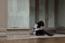 19-03-2021 - Youth writing in a closed shop doorway, Town Centre, Banbury © John Harris