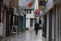 19-03-2021 - Woman walking down the back streets, Banbury Town centre © John Harris