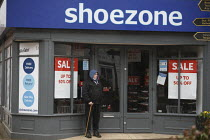 19-03-2021 - Shopper in closed Shoezone shop doorway, Banbury Town centre © John Harris