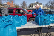 19-03-2021 - Detroit, USA: Handing out meal bags to the poor and hungary. The Upcycling Kitchen at Jefferson Avenue Presbyterian Church makes ready to eat healthy meals from donated food that would otherwise have... © Jim West
