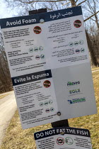 19-03-2021 - Belleville, Michigan, USA, Don't Eat The Fish PFAS pollution sign by the Huron River. Don't swallow Huron River foam ?and keep your pets away from it, Lower Huron Metropark, signs warning against cont... © Jim West