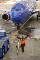 24-03-2021 - Denver International Airport. Aircraft marshaller directing a Southwest Airlines jet on arrival, Colorado, USA © Jim West