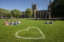 16-07-2020 - Socially distanced hearts painted across College Green, Bristol. Hundreds of giant hearts painted on city centre green spaces to encourage safe social distancing and people to safely enjoy the heart o... © Paul Box