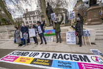 08-04-2021 - Romani activists protest against deportations of Romani people from Central and Eastern Europe following Brexit on Roma Nation Day, Mahatma Gandhi statue, Parliament Square, Westminster, London. © Jess Hurd