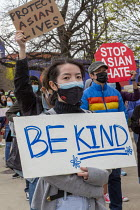 11-04-2021 - Michigan, USA: Protest against anti Asian American hate crimes. Increased violence and racism targeting Asian Americans in America. Be Kind placard © Jim West
