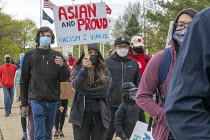 11-04-2021 - Michigan, USA: Protest against anti Asian American hate crimes. Increased violence and racism targeting Asian Americans in America. © Jim West