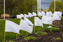 11-04-2021 - Troy, Michigan USA: Memorial to Covid deaths. White flags outside city hall representing the residents of Troy who have died in the coronavirus pandemic. © Jim West
